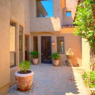 Inspiration for a large rustic brick floor entryway remodel in Phoenix with a dark wood front door