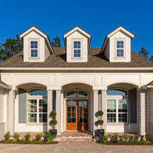 Inspiration for a large timeless entryway remodel in Jacksonville with a glass front door