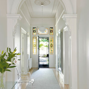 Elegant Light Wood Floor Entryway Photo In Melbourne With White Walls And A Metal  Front Door