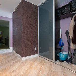 Entryway - mid-sized contemporary travertine floor entryway idea in Ottawa with beige walls and a white front door