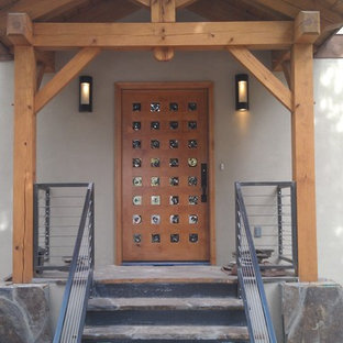 Small trendy entryway photo in Albuquerque with a medium wood front door