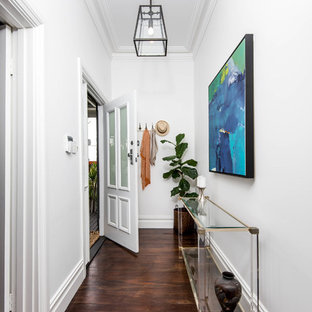 Photo of a contemporary entry hall in Perth with white walls, dark hardwood floors, a single front door and a glass front door.