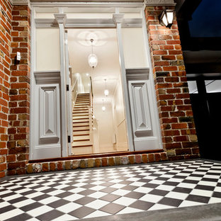 Trendy terrazzo floor entryway photo in Melbourne with white walls and a white front door