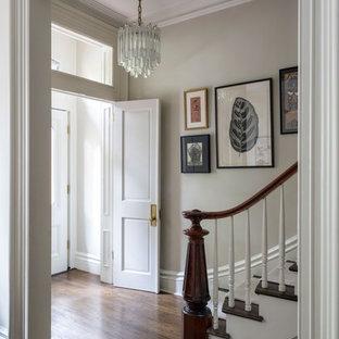 Idéer för att renovera en stor vintage farstu, med grå väggar, mörkt trägolv, en dubbeldörr och en vit dörr