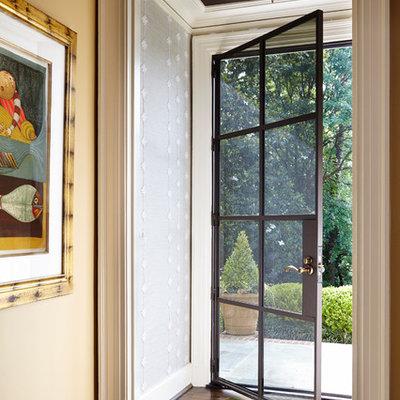 Example of a small transitional dark wood floor single front door design in Atlanta with a glass front door