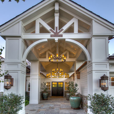 Entryway - large traditional entryway idea in Orange County with a black front door