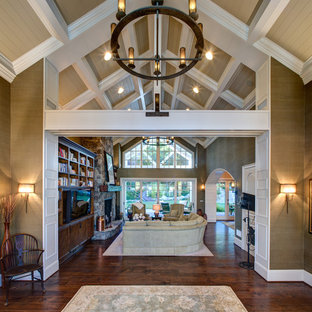 Inspiration for a large timeless dark wood floor and brown floor foyer remodel in Orange County with beige walls