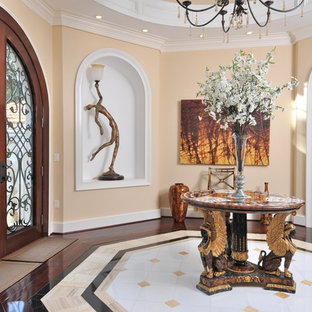 Inspiration for a timeless multicolored floor foyer remodel in Tampa with beige walls