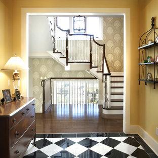 Entryway - traditional dark wood floor and multicolored floor entryway idea in Chicago with yellow walls