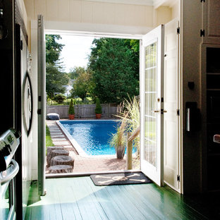 Example of a classic green floor entryway design in Boston