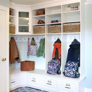 Mudroom - traditional carpeted and multicolored floor mudroom idea in New York with blue walls