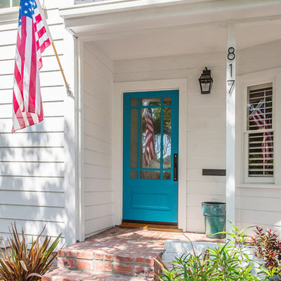 Example of a classic single front door design in Los Angeles with a blue front door