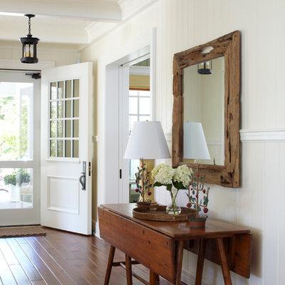 Single front door - traditional single front door idea in Other with a white front door