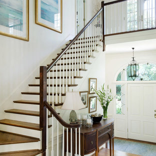 Entryway - traditional medium tone wood floor and brown floor entryway idea in Other with white walls and a white front door