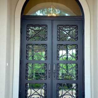 Large elegant entryway photo in Miami with a metal front door
