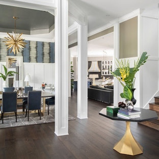 Inspiration for a huge contemporary dark wood floor and brown floor entryway remodel in Los Angeles with white walls and a medium wood front door