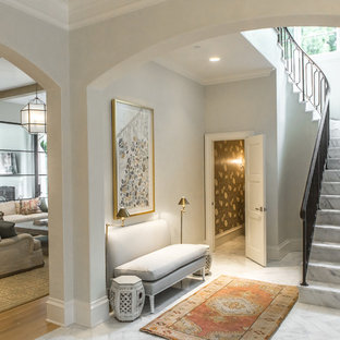 Transitional marble floor foyer photo in Dallas with white walls