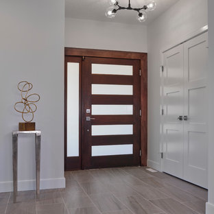 Example Of A Mid Sized Transitional Ceramic Floor And Gray Entryway Design In Edmonton