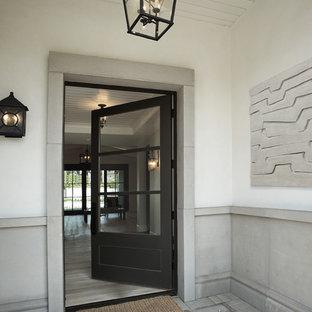 Неиссякаемый источник вдохновения для домашнего уюта: большой вестибюль в стиле современная классика с одностворчатой входной дверью, черной входной дверью, желтыми стенами, бетонным полом, серым полом, потолком из вагонки и панелями на части стены