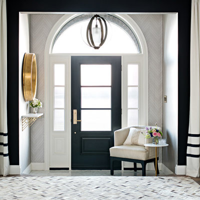 Example of a transitional dark wood floor entryway design in Toronto with gray walls and a black front door