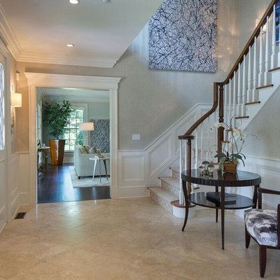 Mid-sized transitional travertine floor and beige floor entryway photo in New York with gray walls and a dark wood front door