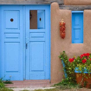サンフランシスコの両開きドアサンタフェスタイルのおしゃれな玄関ドア (青いドア) の写真