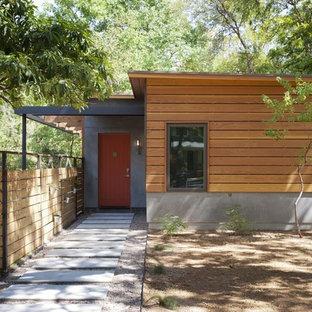 Свежая идея для дизайна: прихожая в современном стиле с оранжевой входной дверью - отличное фото интерьера