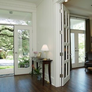 Inspiration for a timeless dark wood floor double front door remodel in Austin with a glass front door