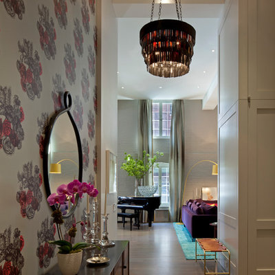 Trendy light wood floor entryway photo in New York with white walls