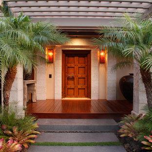 Entryway - tropical entryway idea in Hawaii with a dark wood front door