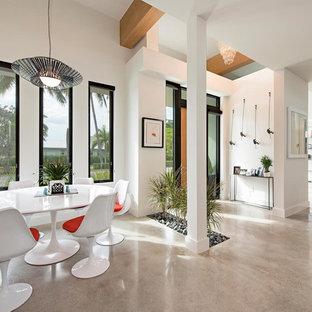 Small Minimalist Concrete Floor Entryway Photo In Miami With White Walls