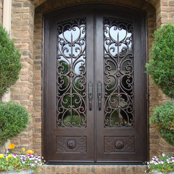Tuscan iron entries tuscany design tuscany design for Mediterranean style front doors