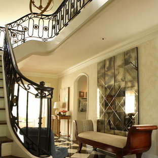 Example of a classic foyer design in Atlanta with beige walls