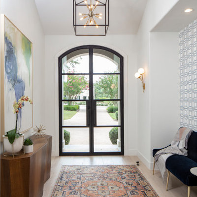 Entryway - mid-sized transitional light wood floor and beige floor entryway idea in Austin with white walls and a glass front door