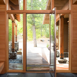 Inspiration for a contemporary front door remodel in Minneapolis with a glass front door