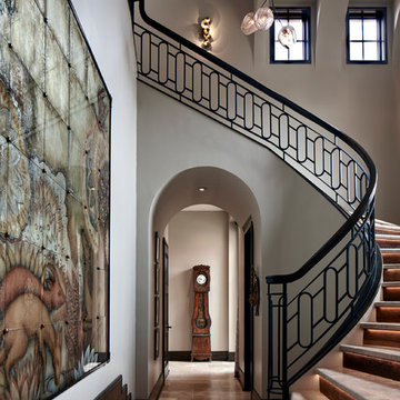 Two-Story Foyer with Curved Staircase with Metal Railing