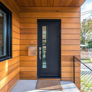 Ispirazione per una porta d'ingresso minimalista con una porta singola e una porta nera