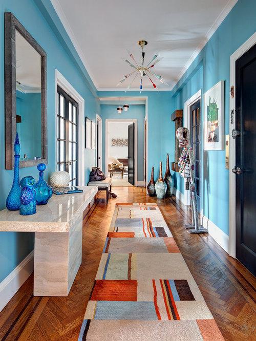 black entry door. Contemporary medium tone wood floor and orange entryway idea in New  York with blue walls Black Entry Door Houzz