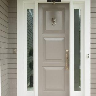Idéer för vintage ingångspartier, med grå väggar, betonggolv, en enkeldörr och en grå dörr