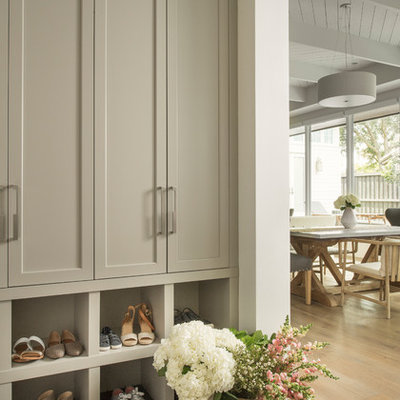 Example of a transitional gray floor mudroom design in Orlando with white walls
