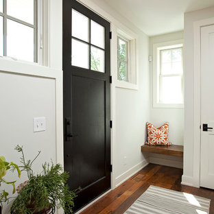 Country Brown Floor Entryway Photo In Minneapolis With White Walls