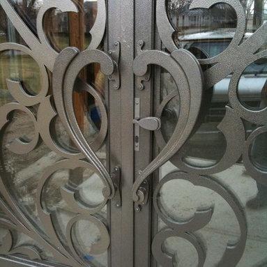 V top Entrance Doors by Arttig - 8 f. x 18 f. powder coated in bronze vain color.
