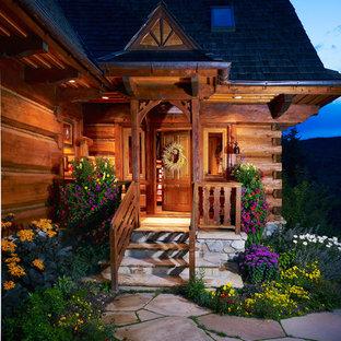 Entryway - rustic entryway idea in Denver with a medium wood front door