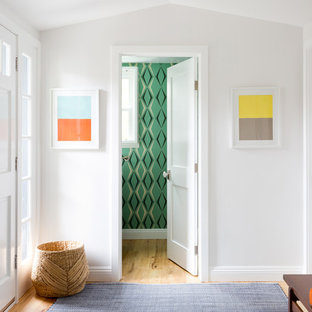 Inspiration for a transitional light wood floor and beige floor entryway remodel in Los Angeles with white walls and a white front door