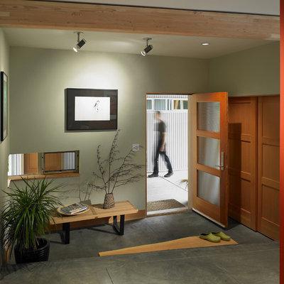 Trendy concrete floor and gray floor entryway photo in Seattle