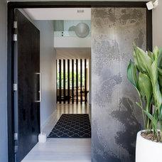 Contemporary Entry by Denai Kulcsar Interiors