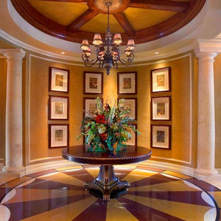 Large elegant laminate floor and brown floor entryway photo in San Francisco with beige walls and a glass front door