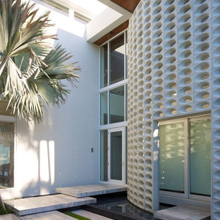 Inspiration for a contemporary single front door remodel in Miami with a glass front door