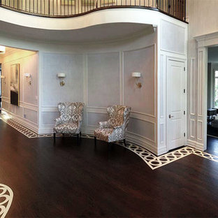Foyer - large transitional painted wood floor foyer idea with white walls