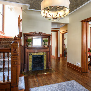 Example of an ornate bamboo floor entryway design in Chicago with brown walls